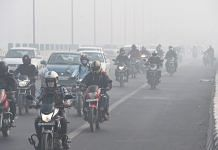 Vehicles ply amid low visibility due to smog, in New Delhi on 10 November