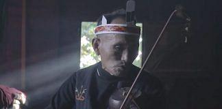 Ningmaso Awungshi playing the Tingteilla, a traditional instrument of Tangkhul Nagas   Credits: Kora Studios   YouTube