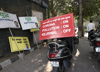 Placards displayed during a BJP protest against the Delhi government over the issue of pollution and the rise in Covid cases | PTI