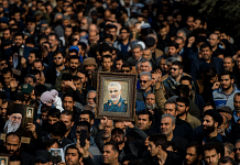 Protesters hold up an image of Qassem Soleimani, an Iranian commander, during a demonstration following the US airstrike in Iraq which killed him | Photographer: Ali Mohammadi/Bloomberg