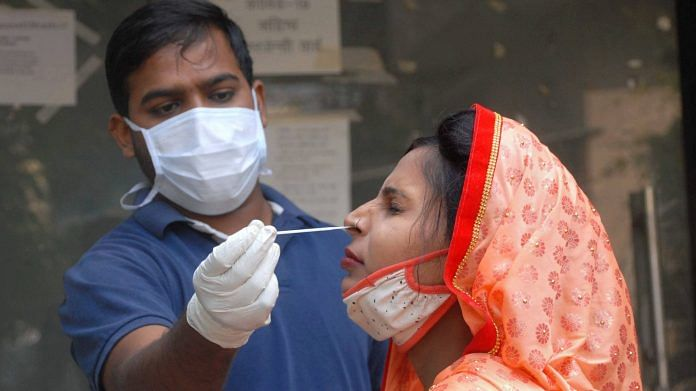 A health worker conducts COVID-19 testing at a district hospital, in Noida, Tuesday, Nov. 17, 2020. | PTI