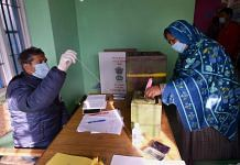 A woman casts her vote for the first phase of the District Development Council (DDC) elections, at Gund in Ganderbal district of central Kashmir, Saturday, Nov. 28, 2020. | PTI