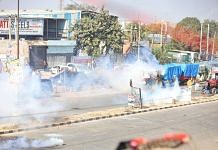 Police use tear gas to disperse farmers protesting against Centre's farm laws, at Singhu border Friday | Photo: Manisha Mondal | ThePrint