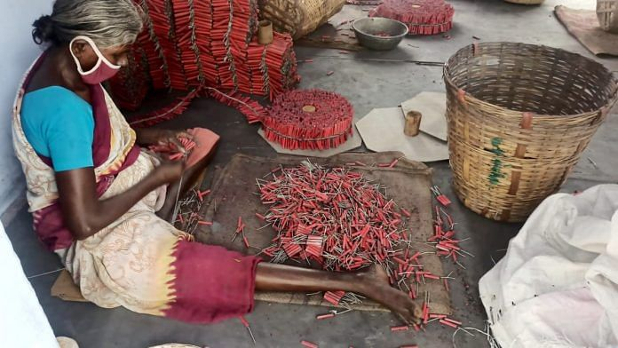 A woman makes crackers at a unit in Sivakasi, the firecracker manufacturing hub in the country | Photo: ANI