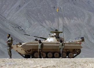 Representational image of an Indian Army tank and personnel in Ladakh | File photo: ANI