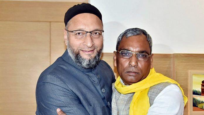 AIMIM chief Asaduddin Owaisi with SBSP president Om Prakash Rajbhar in Lucknow Wednesday | Photo: ANI