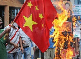 File image of a Chinese flag and an effigy of President Xi Jinping being burnt during a protest against the Galwan Valley clash, in Kolkata | Representational image | ANI