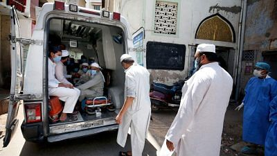 File photo of medical workers in Ahmedabad taking people who had attended the Tablighi Jamaat event in New Delhi to a quarantine facility