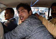File photo of Kapil Gujjar being taken away by police | PTI