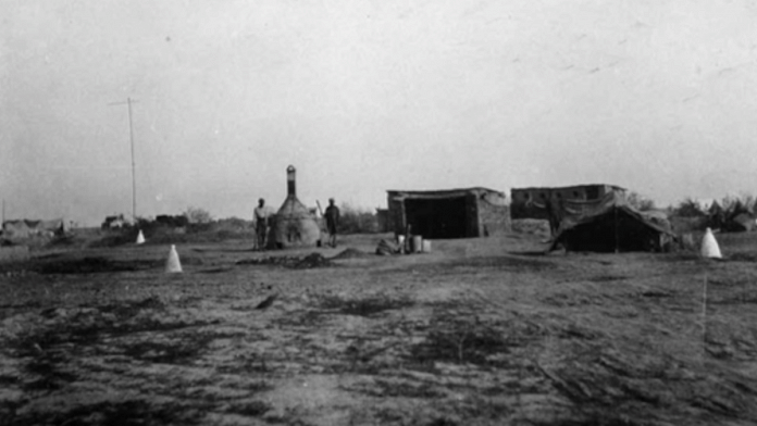 The Tigris Front, Iraq (formerly Mesopotamia), First Corps British Army camp sanitary area | View of closed incinerator, sweeper's tent, drying shed for litter and latrine huts | Radhika Singha/HarperCollins