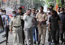 File photo | Gangster Vikas Dubey being apprehended by police personnel in Ujjain on 9 July | PTI Photo