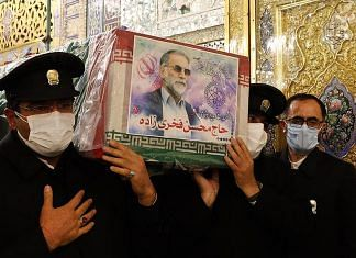 The casket of assassinated nuclear scientist Mohsen Fakhrizadeh being carried | @ImamRezaEN | Twitter