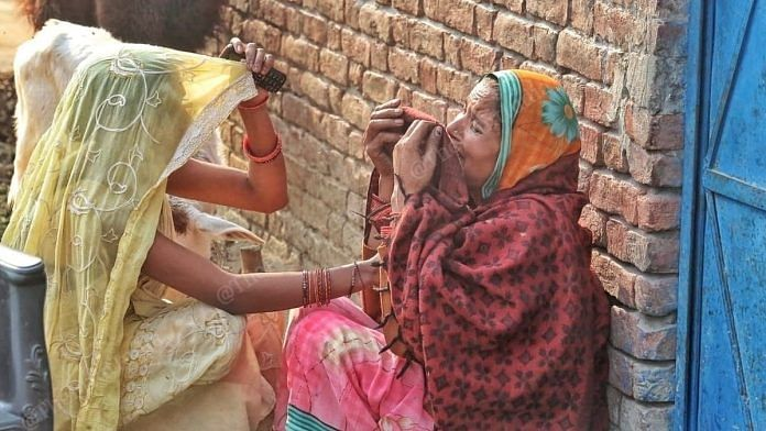 Nitu Shukla's mother Rekha, crying in the arms in front of her house at Makhi Beher village in Sitapur, Uttar Pradesh.   Photo: Praveen Jain/ThePrint