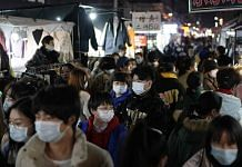 Shoppers at a night market in Wuhan on 10 December