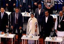 File image of West Bengal CM Mamata Banerjee (centre) and Finance Minister Amit Mitra (right) with global industrialists including Mukesh Ambani at the Bengal Global Business Summit in February 2019   Photo: ANI