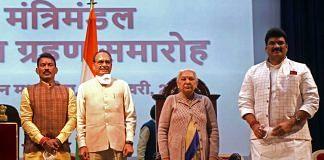 Newly-inducted ministers Tulsiram Silawat (left) and Govind Rajput (right) with Madhya Pradesh CM Shivraj Singh Chouhan and Governor Anandiben Patel Sunday | Photo: ANI