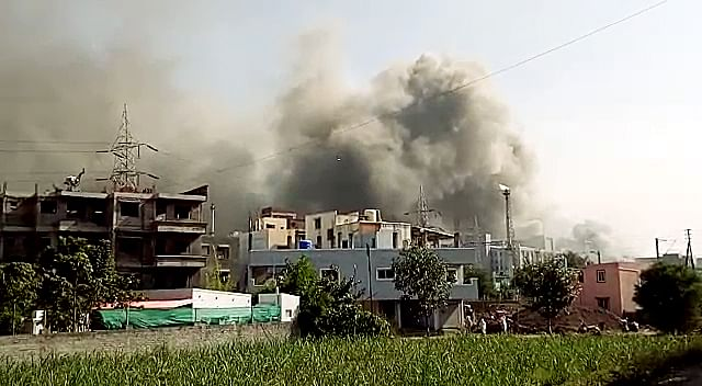 Smoke billows out as fire broke out at the under-construction building at Serum Institute of India in Pune on Thursday. | ANI
