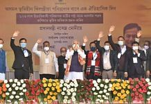Prime Minister Narendra Modi along with Assam CM Sarbananda Sonowal and others before distributing 'Land Patta' to people during a public meeting, at Jerenga Pathar in Sivasagar District of Assam, Saturday, Jan. 23, 2021. | PTI