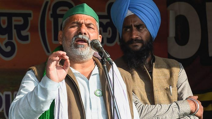 Bharatiya Kisan Union Spokesperson Rakesh Tikait addresses farmers during their ongoing protest against the new farm laws, at Ghazipur border in New Delhi, on 28 January, 2021 | PTI