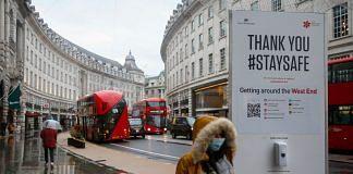 A pedestrian walks along Regent Street in London on Jan. 5.   Photographer: Hollie Adams   Bloomberg