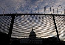 Temporary security fencing at the US Capitol in Washington, Tuesday, 19 January 2021, a day before Joe Biden is to be sworn in as President | Stefani Reynolds | Bloomberg