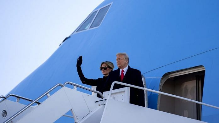Former US President Donald Trump and Melania Trump board Air Force One during a farewell ceremony at Joint Base Andrews, Maryland, US, on Wednesday, Jan. 20, 2021. | Photographer: Stefani Reynolds | Bloomberg
