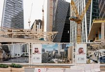 Portraits of Mohammed bin Salman and King Salman at a construction site in the King Abdullah Financial District in Riyadh. | Photographer: Tasneem Alsultan | Bloomberg