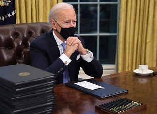 US President Joe Biden sits in the Oval Office after being sworn in on 20 January, 2021 | Bloomberg
