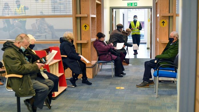 A staff member calls through visitors to receive the AstraZeneca vaccine at the in Oldham, UK (representational imahe) | Photographer: Anthony Devlin | Bloomberg