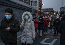 Residents of Dongcheng District in Beijing line up for Covid-19 testing on 22 January 2021 | Photographer: Kevin Frayer/Getty Images via Bloomberg