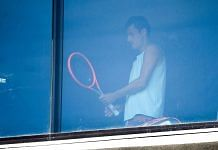 Australian tennis player Bernard Tomic exercises in his hotel room in Melbourne in January 17, 2021, as players quarantine in hotels ahead of the Australian Open tennis tournament | Photographer: William | West/AFP/Getty Images via Bloomberg