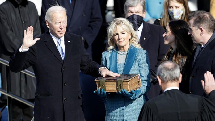 Joe Biden takes oath as the US president during the inauguration ceremony in Washington, DC, on 20 January   Photo: Daniel Acker   Bloomberg
