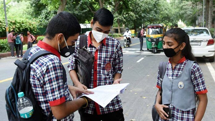 Students revising outside a school during the CBSE compartment examination, in New Delhi in September 2020 | ANI File Photo