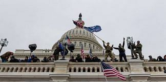Demonstrators attempt to enter the US Capitol building during a protest in Washington, D.C., U.S., on 6 January 2021 | Eric Lee | Bloomberg