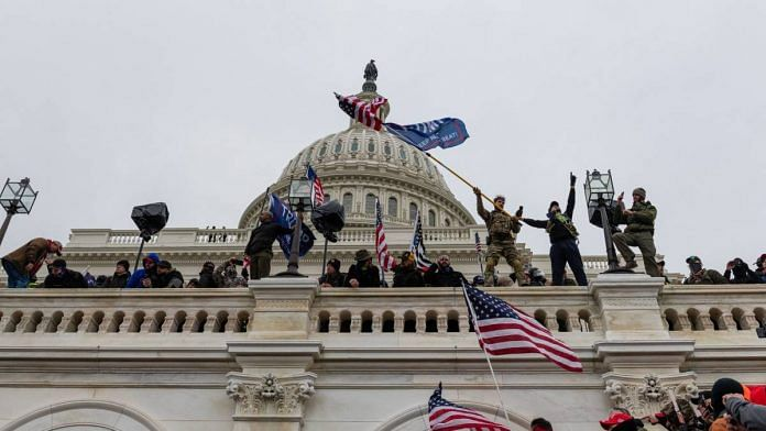 Demonstrators attempt to enter the US Capitol building during a protest in Washington, D.C., U.S., on 6 January 2021   Eric Lee   Bloomberg