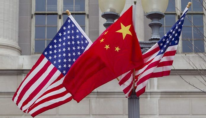 File photo   Flags of the US and China fly along Pennsylvania Avenue in Washington   D.C Andrew Harrer/Bloomberg