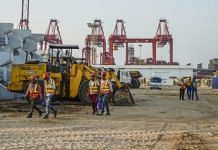 (Representational image) Workers walk past excavators at the site of Colombo Port City, developed by China Harbour Engineering Co | Atul Loke | Bloomberg