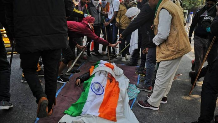 Protesters gathered around the body of a farmer who died during the tractor rally that turned violent on Republic Day in New Delhi on 26 January 2021 | Suraj Singh Bisht | ThePrint