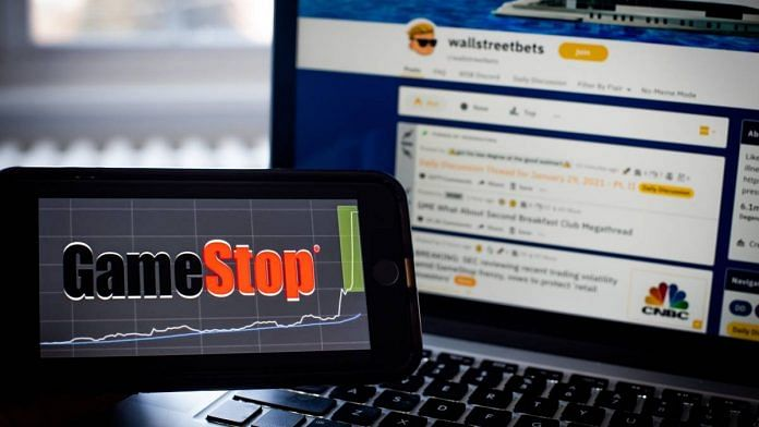 The WallStreetBets forum on Reddit website and the GameStop Corp. logo | Tiffany Hagler-Geard | Bloomberg