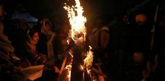 Farmers burnt copies of the three contentious farm laws during Lohri celebrations at Singhu border Wednesday   Photo: Manisha Mondal   ThePrint