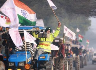 Famers during a tractor rally at Singhu border in New Delhi, on 26 January 2021