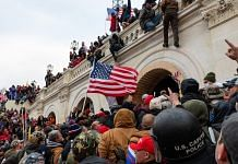 Demonstrators attempt to enter the US Capitol building during a protest in Washington, DC on 6 January   Photo: Eric Lee   Bloomberg