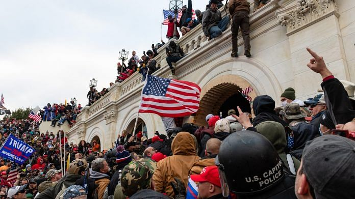Demonstrators attempt to enter the US Capitol building during a protest in Washington, DC on 6 January | Photo: Eric Lee | Bloomberg