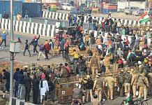 Farmers break through Delhi Police barricades at the Ghazipur border as they move towards Akshardham during their tractor rally on Republic Day in New Delhi, on 26 January 2021 | Vijay Verma | PTI