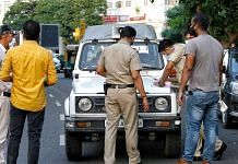 Police personnel writing out a challan in New Delhis' Connaught Place   ANI File Photo