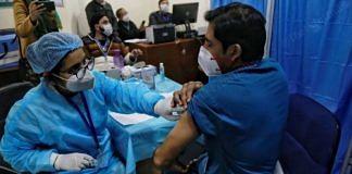 A health worker administering a Covid-19 vaccine shot | Manisha Mondal | ThePrint