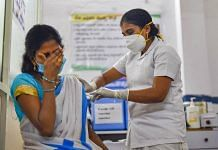 A medic administers the first vaccine dose to a frontline worker, after the virtual launch of Covid-19 vaccination drive by Prime Minister Narendra Modi, at a health center in Visakhapatnam on 16 January 2021   PTI