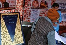 Copies of the Constitution of India are available for sale at a new book stall at the Singhu Border protest site outside Delhi | Photo: Manisha Mondal | ThePrint
