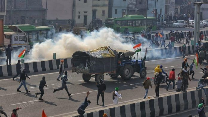 Protesting farmers clashed with police at several places in the national capital after tractor rally turned violent, on 26 January 2021   Photo: Suraj Bisht Singh   ThePrint