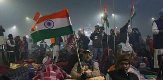 A protestor wave national flag at Ghazipur protest site | Photo: Manisha Mondal | ThePrint